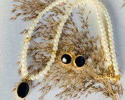 zwart onyx ketting oorbellen verguld